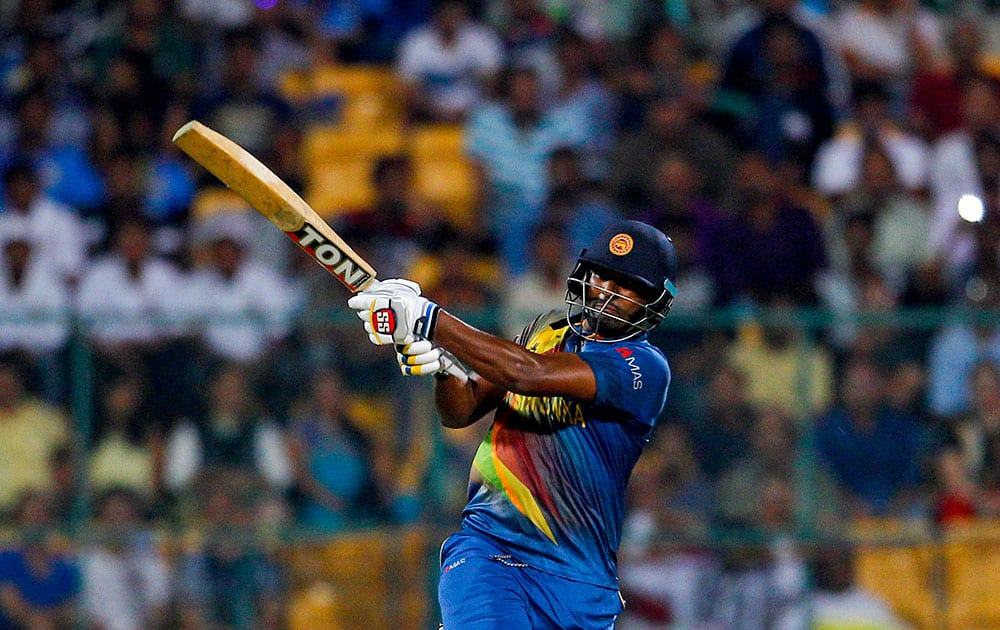 Sri Lanka's Thisara Perera plays a shot during their ICC World Twenty20 2016 cricket match against West Indies' in Bangalore.