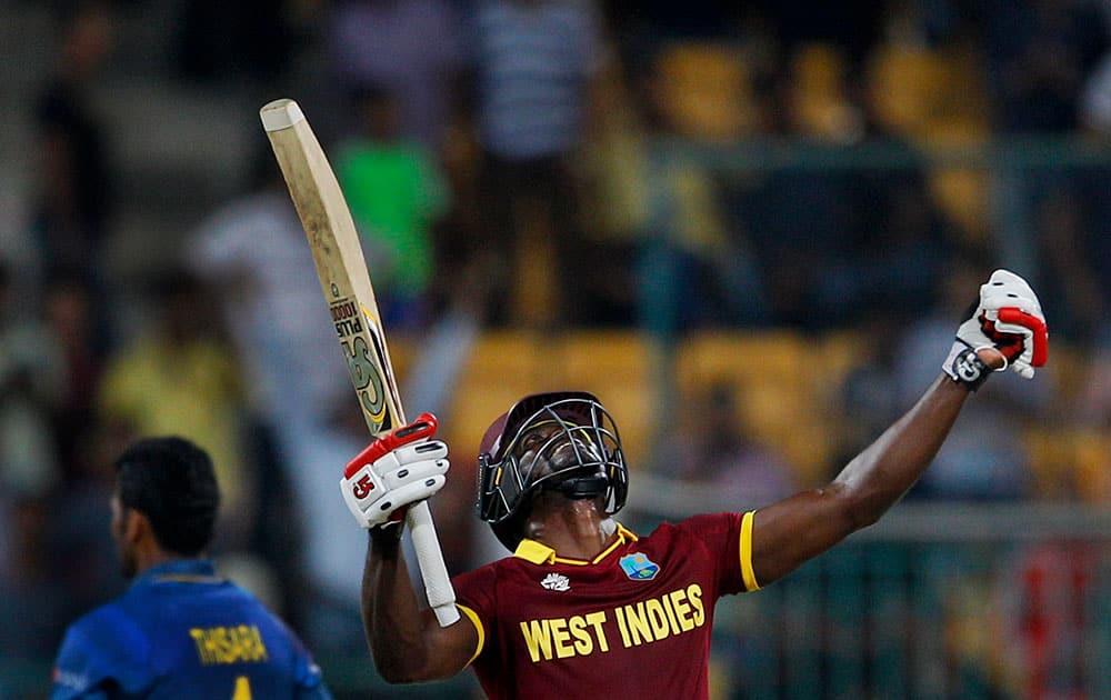 West Indies' Andre Fletcher celebrates his team's win over Sri Lanka in the ICC World Twenty20 2016 cricket match in Bangalore.