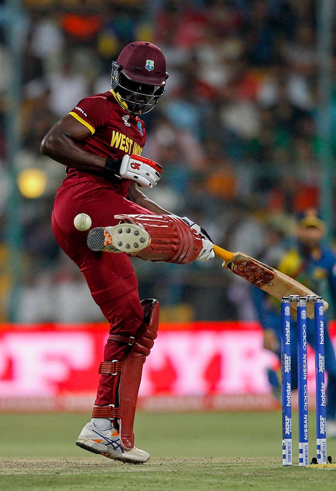 West Indies' Andre Fletcher kicks away the ball to avoid getting out during their ICC World Twenty20 2016 cricket match against Sri Lanka in Bangalore.