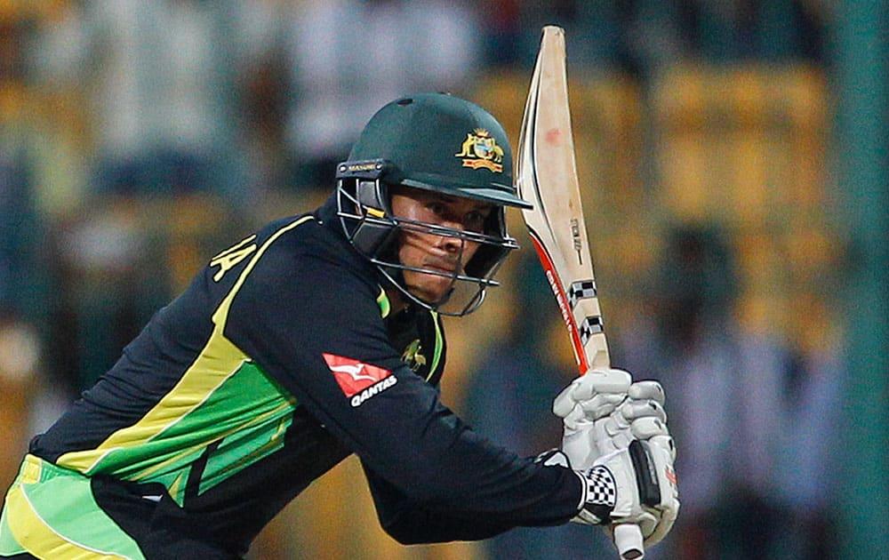 Australia's Usman Khawaja plays a shot during their ICC World Twenty20 2016 cricket match against Bangladesh in Bangalore.