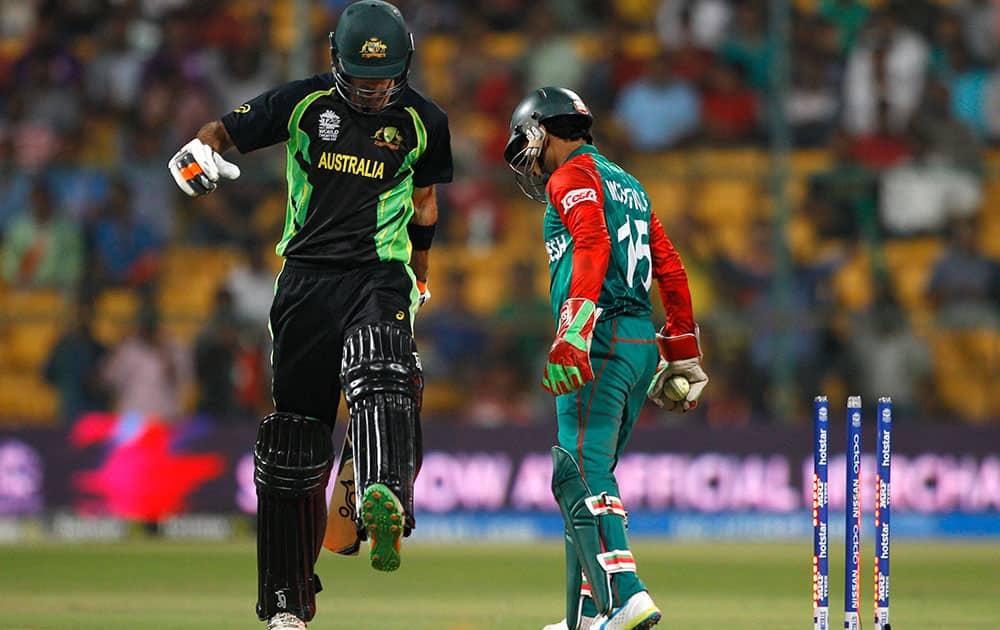 Bangladesh's Shakib Al Hasan, center, reacts as Australia's John Hastings, left, and James Faulkner run between the wickets during their ICC World Twenty20 2016 cricket match in Bangalore.