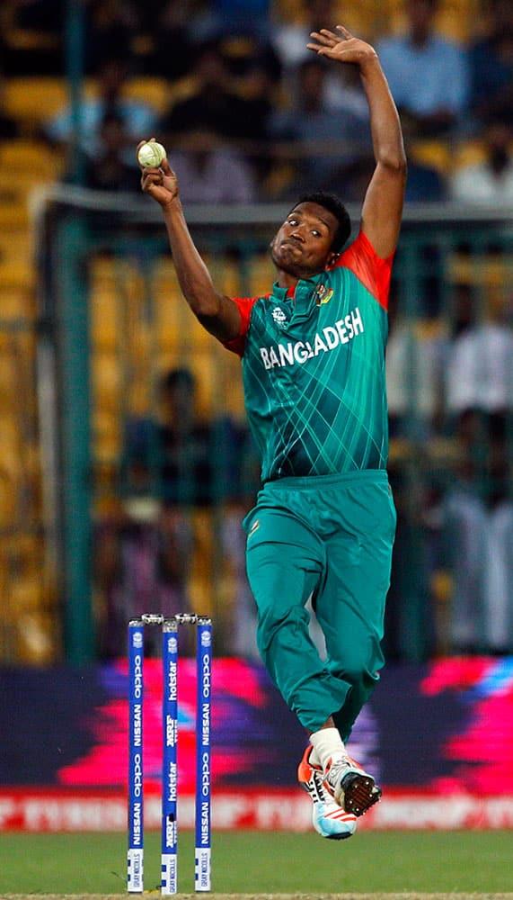 Bangladesh's Al-Amin Hossain bowls during their ICC World Twenty20 2016 cricket match against Australia in Bangalore.