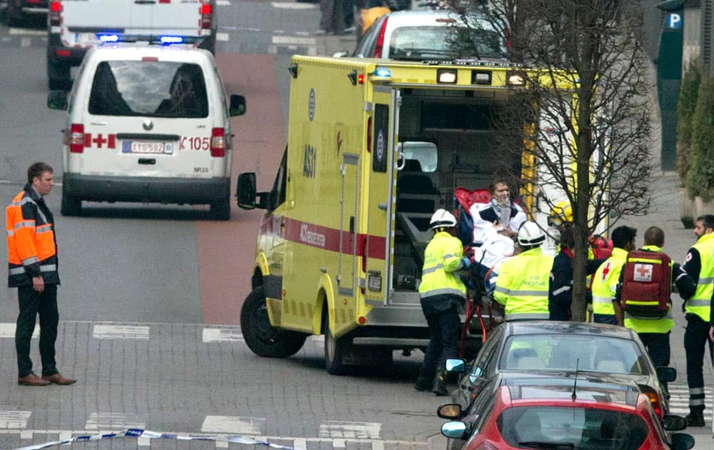 A woman is evacuated in an ambulance by emergency services after a explosion in a main metro station in Brussels.