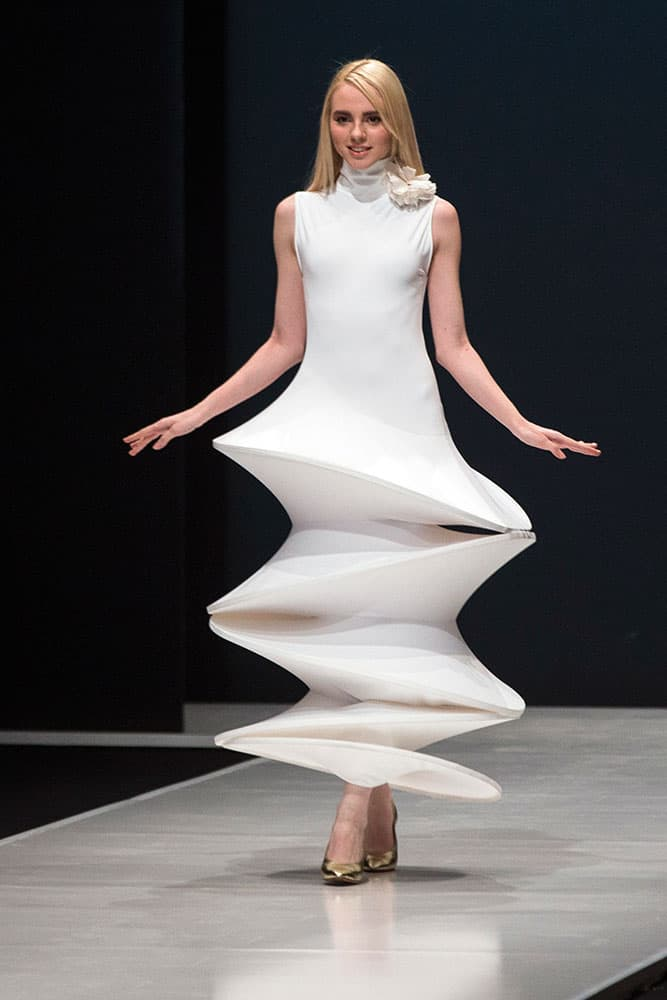 A model displays a creation by French fashion designer Pierre Cardin during Moscow Fashion Week, Russia.