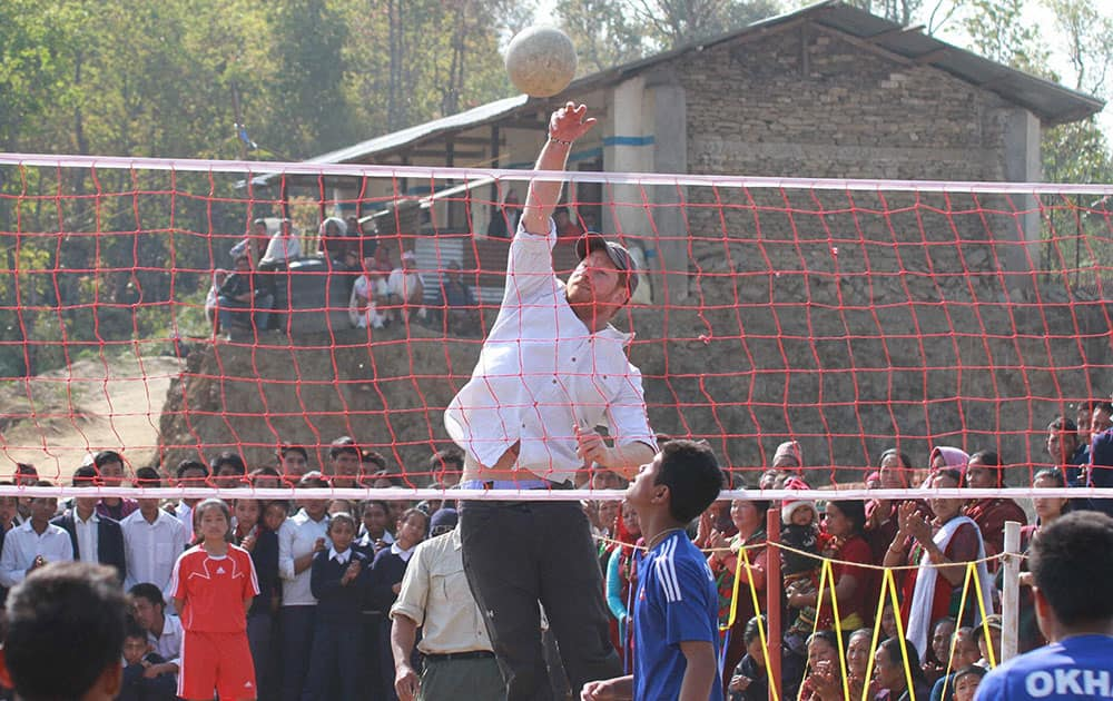 Britains Prince Harry plays volleyball with local students during his visit in Lamjung District District, Nepal.