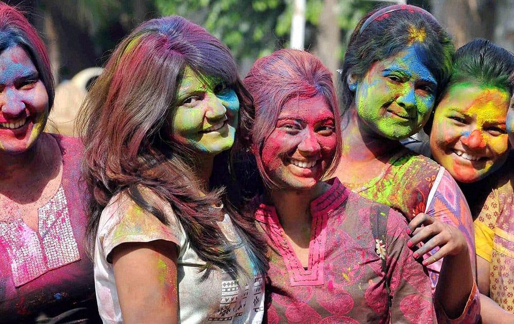Students of Presidency University playing holi to celebrate Basant Utsav at their university campus in Kolkata.