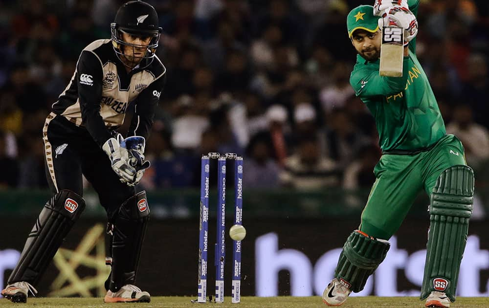 Pakistan's Ahmed Shehzad plays a shot during their ICC World Twenty20 2016 cricket match against New Zealand in Mohali.