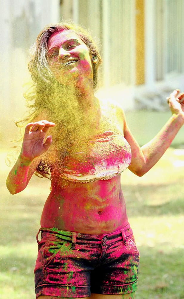 Bollywood and Marathi films actress Kesariee is daubed in colors while celebrating Holi in Mumbai.