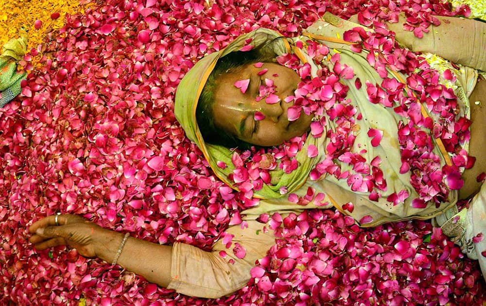A widow takes part in flower Holi celebrations at Gopinath Temple, Vrindavan in Mathura.