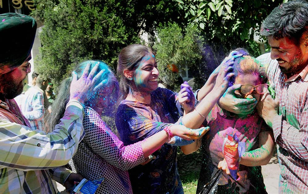 Students celebrate Holi in Amritsar.