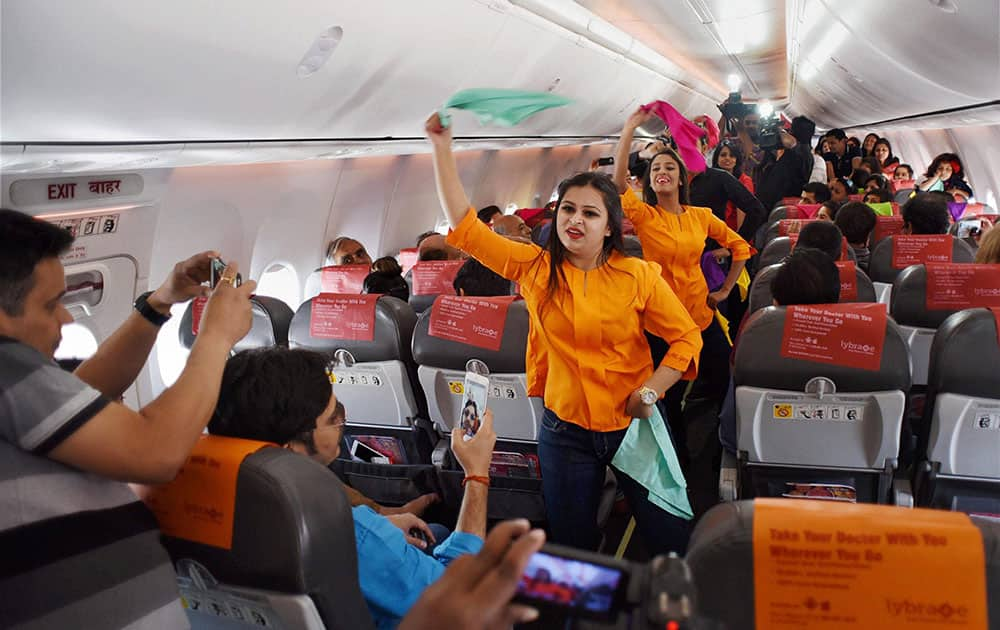 Inflight crew on board a SpiceJet Delhi Goa flight perform a Holi dance post boarding before take off in New Delhi.