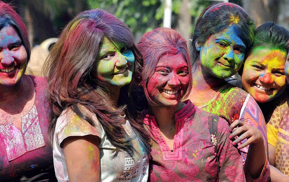 Students of Presidency University playing holi to celebrate Basant Utsav at their university campus in Kolkata.