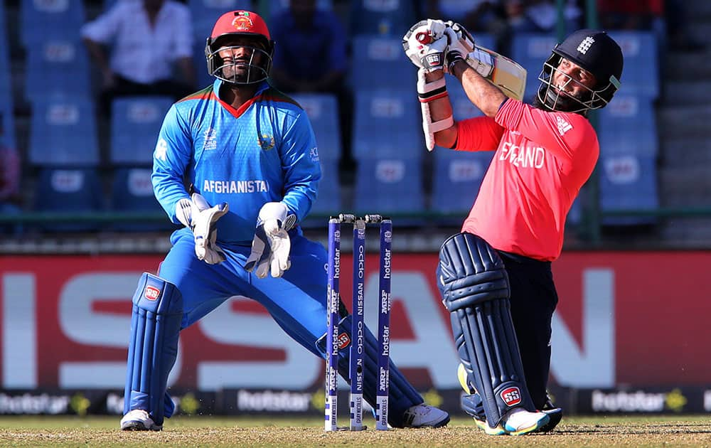 England's Moeen Ali plays a shot while playing against Afghanistan during their ICC Twenty20 2016 Cricket World Cup match at the Feroz Shah Kotla cricket stadium in New Delhi.