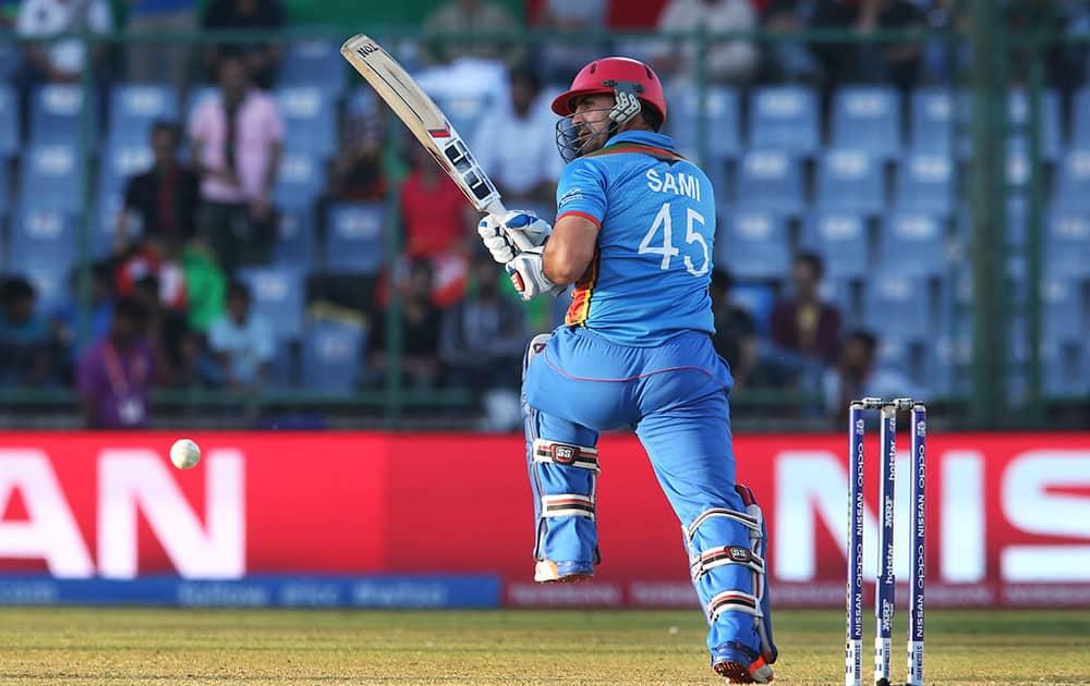 Afghanistan's Samiullah Shenwari plays a shot against England during their ICC Twenty20 2016 Cricket World Cup match at the Feroz Shah Kotla cricket stadium in New Delhi.