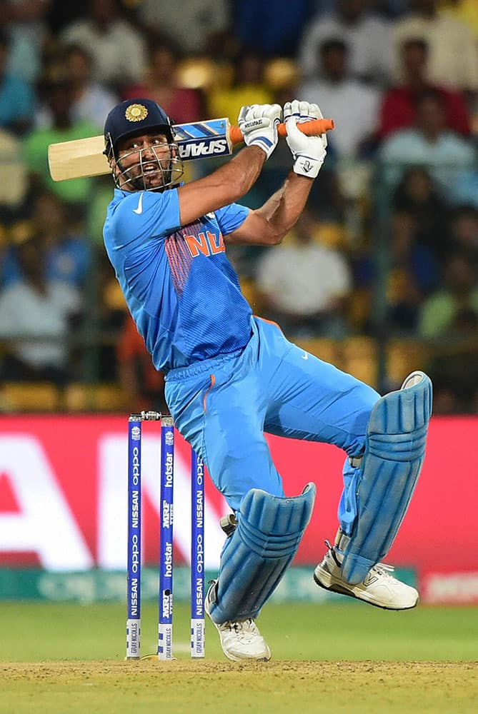 Indias M S Dhoni plays a shot during the ICC World T20 match between India and Bangladesh at Chinnaswamy Stadium in Bengaluru.