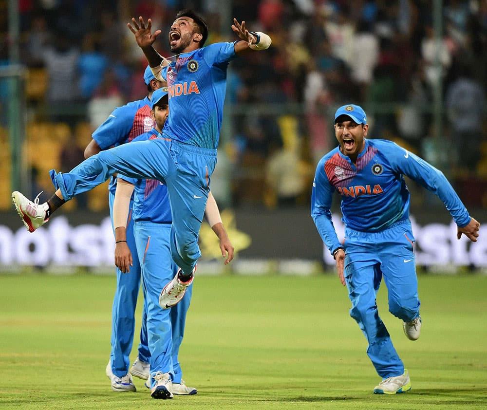 Indias Hardik Pandya with team mates celebrate the win over Bangladesh during the ICC World T20 match between India and Bangladesh at Chinnaswamy Stadium in Bengaluru.