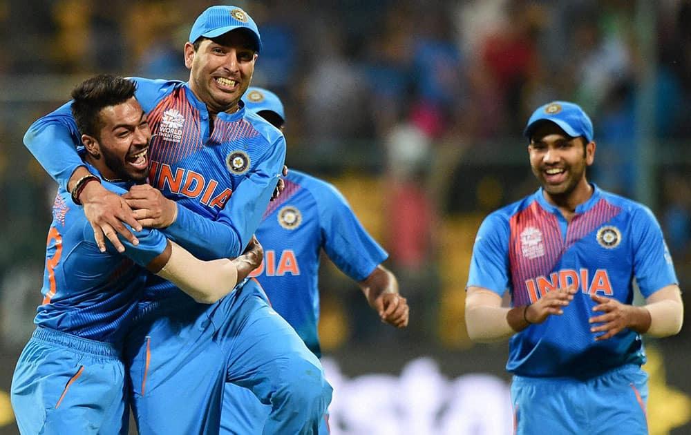 Indias Hardik Pandya celebrates the win over Bangladesh during the ICC World T20 match between India and Bangladesh at Chinnaswamy Stadium in Bengaluru.