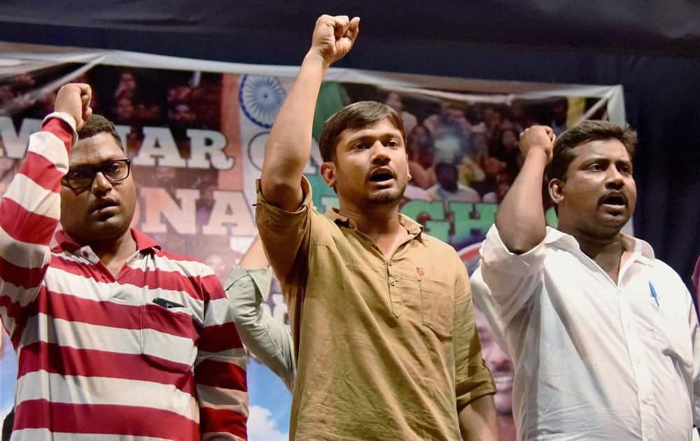 JNU student's union President Kanhaiya Kumar along with other student representative's shout slogans at a seminar on Constitution rights in Hyderabad.