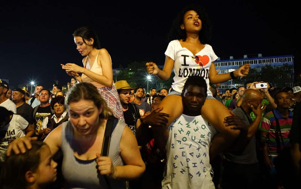 People dance at the Rolling Stones concert in Havana, Cuba.