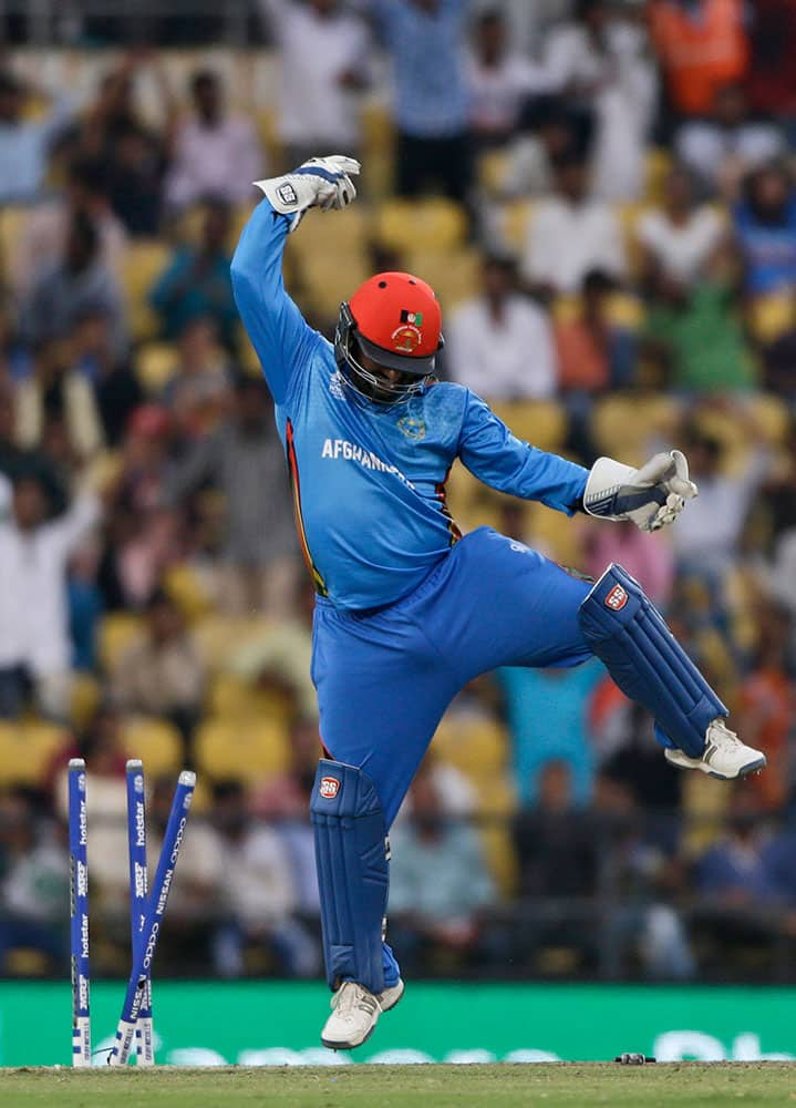 Afghanistan's wicketkeeper Mohammad Shahzad celebrates after stumping West Indies' batsman Denesh Ramdin during their ICC World Twenty20 2016 cricket match in Nagpur.