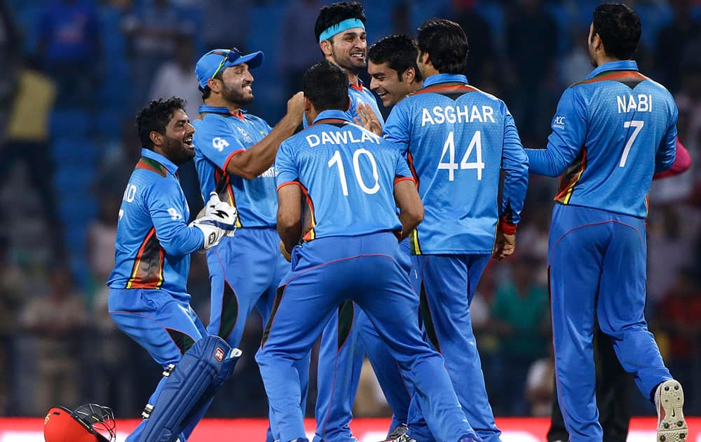 Afghanistan's cricketers celebrate their win over West Indies' in the ICC World Twenty20 2016 cricket match in Nagpur.
