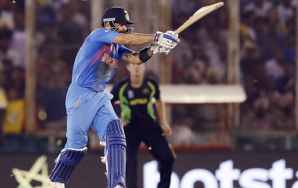 India's Virat Kohli bats during their ICC World Twenty20 2016 cricket match against Australia in Mohali.