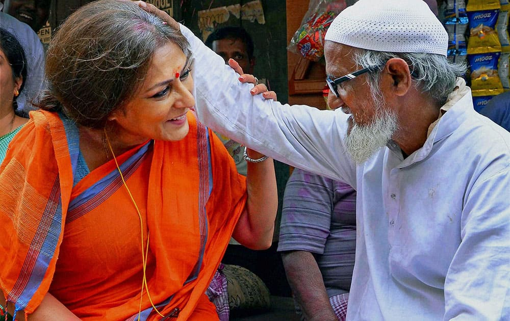 Actress turned BJP leader and party candidate from Howrah-North constituency Rupa Ganguly with an elderly muslim during her election campaign for the upcoming Assembly polls in Howrah.