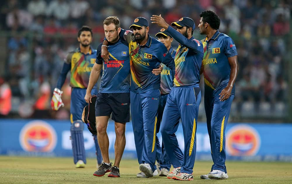 Sri Lanka's Lahiru Thirimanne is injured during their ICC Twenty20 2016 Cricket World Cup match against South Africa at the Feroz Shah Kotla Cricket Stadium in New Delhi.