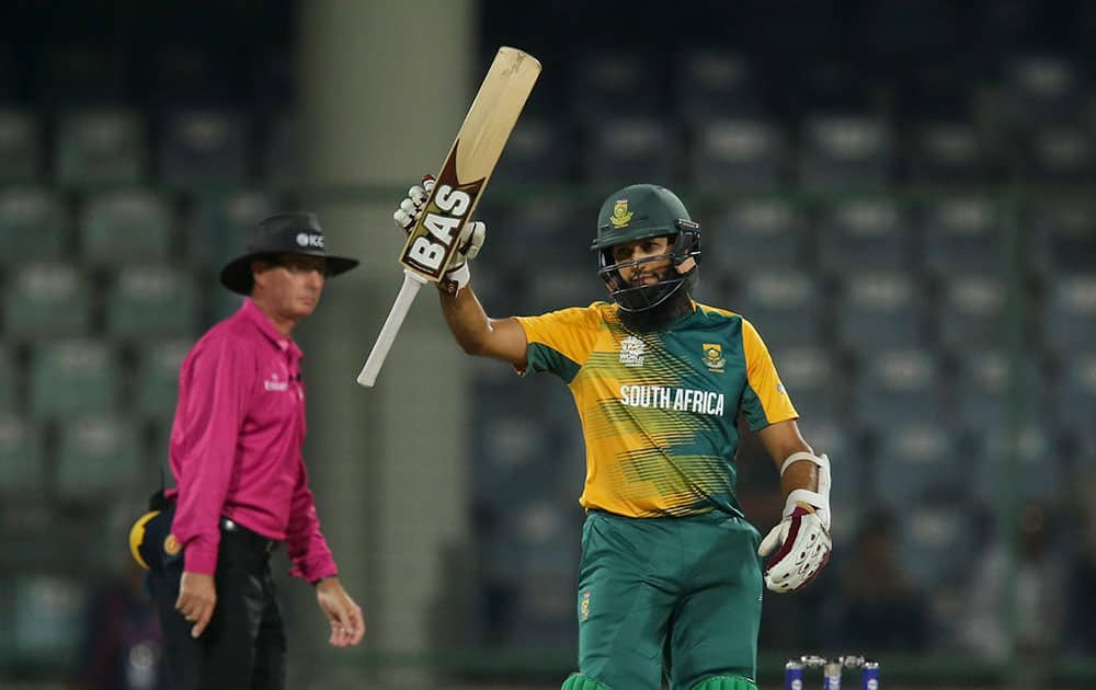 South Africa's Hashim Amla acknowledges his fifty runs against Sri Lanka during their ICC Twenty20 2016 Cricket World Cup match at the Feroz Shah Kotla Cricket Stadium in New Delhi.