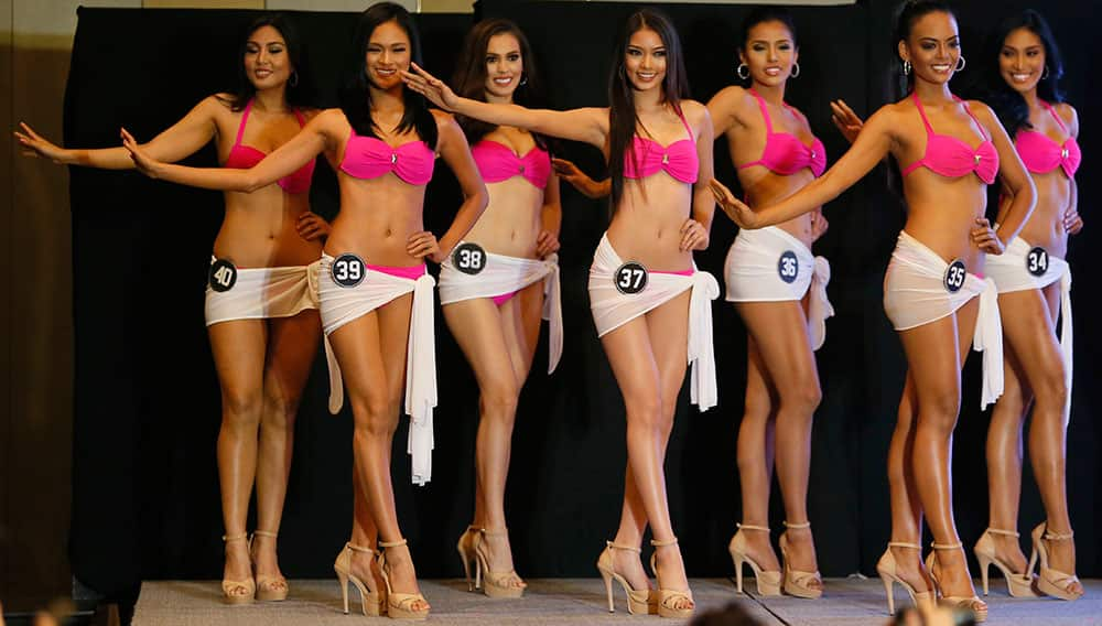 Filipino beauty contestants perform during a media presentation for this year's Binibining Pilipinas (Miss Philippines) beauty pageant at suburban Quezon city northeast of Manila.