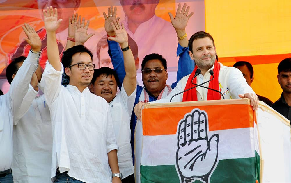 Congress Vice President Rahul Gandhi with party candidates at an election rally at Kasa Stadium in Diphu, Assam.