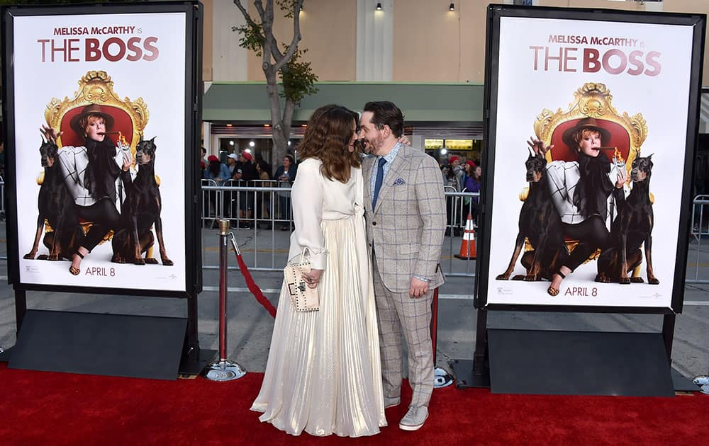 Melissa McCarthy, left, and Ben Falcone arrive at the world premiere of