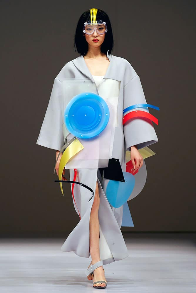 A model presents a creation for Beijing Institute of Fashion Technology Emerging Design Collection at the 'BIFT ELLASSAY' Scholarship Awarding Ceremony during China Fashion Week in Beijing.