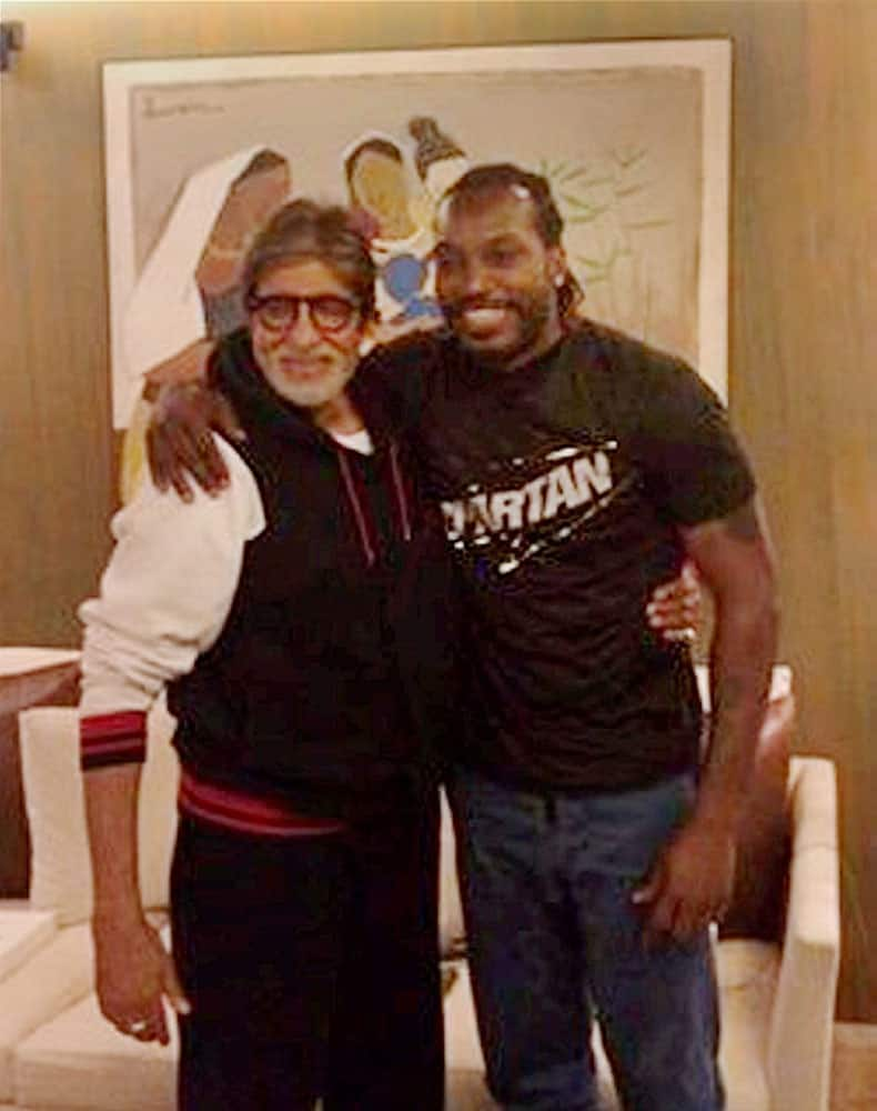 Actor Amitabh Bachchan with West Indies batsman Chris Gayle in Mumbai on Tuesday. India is set to face the Caribbean team in the semi-finals of ICC World T20.