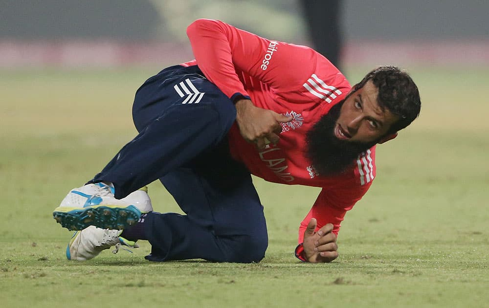 England's Moeen Ali takes a catch during their ICC Twenty20 2016 Cricket World Cup semifinal match against New Zealand at the Feroz Shah Kotla Cricket Stadium in New Delhi.