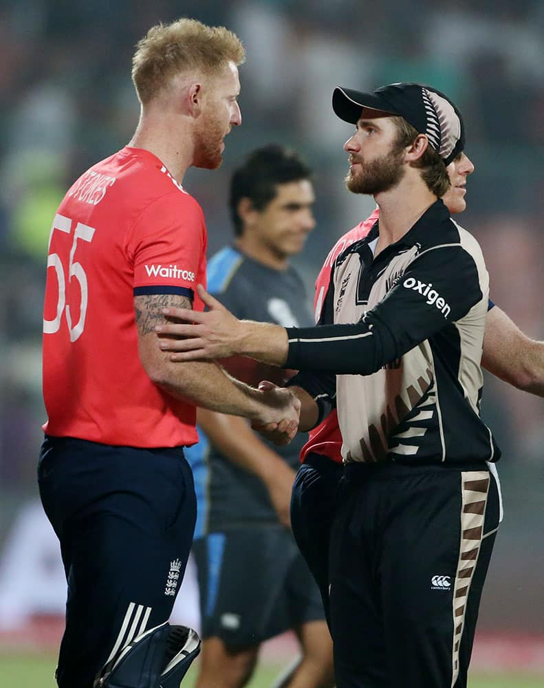 England's Ben Stokes, left, shakes hands with New Zealand's Kane Williamson after their ICC Twenty20 2016 Cricket World Cup semifinal match at the Feroz Shah Kotla Cricket Stadium in New Delhi.