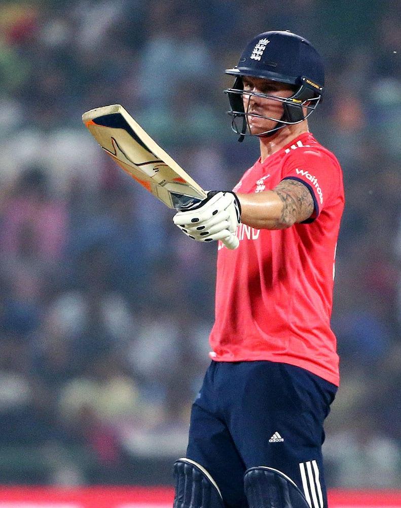 England's Jason Roy waves his bat after getting 50 runs during their ICC Twenty20 2016 Cricket World Cup semifinal match against New Zealand at the Feroz Shah Kotla Cricket Stadium in New Delhi.