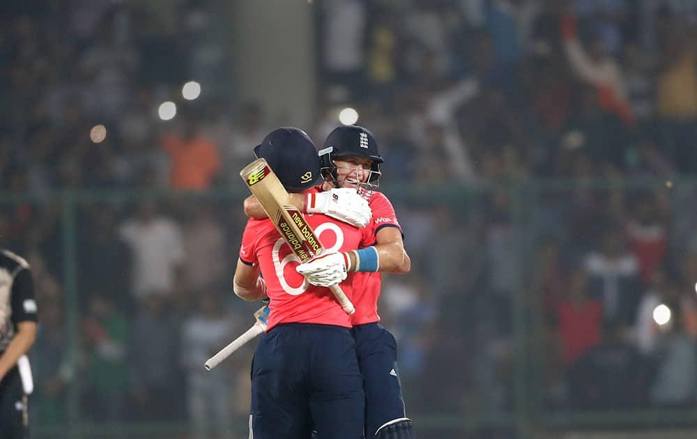 England's Joe Root, facing camera, hugs teammate Jos Buttler after defeating New Zealand during their ICC Twenty20 2016 Cricket World Cup semifinal match at the Feroz Shah Kotla Cricket Stadium in New Delhi.