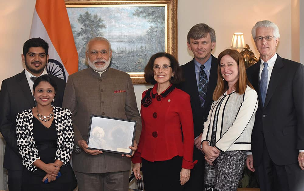 Prime Minister Narendra Modi poses with a group of Scientists including some of Indian origin from Laser Interferometer Gravitational Wave Observatory (LIGO) after their bilateral meeting in Washington.
