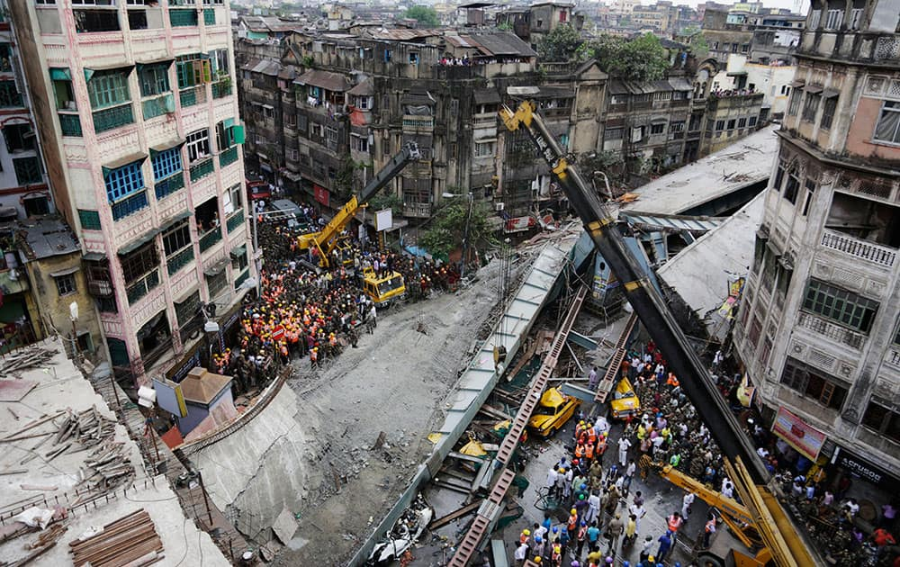 Rescue workers clear the rubbles of a partially collapsed overpass in Kolkata.