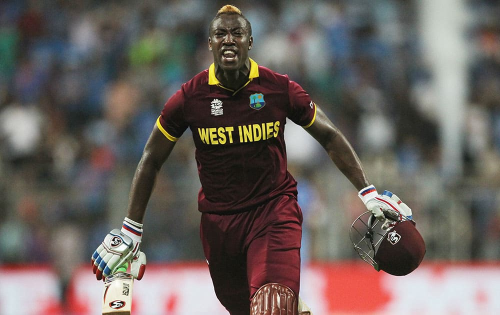 West Indies Andre Russell celebrates after his team's win over India during their ICC World Twenty20 2016 cricket semifinal match at Wankhede stadium in Mumbai.