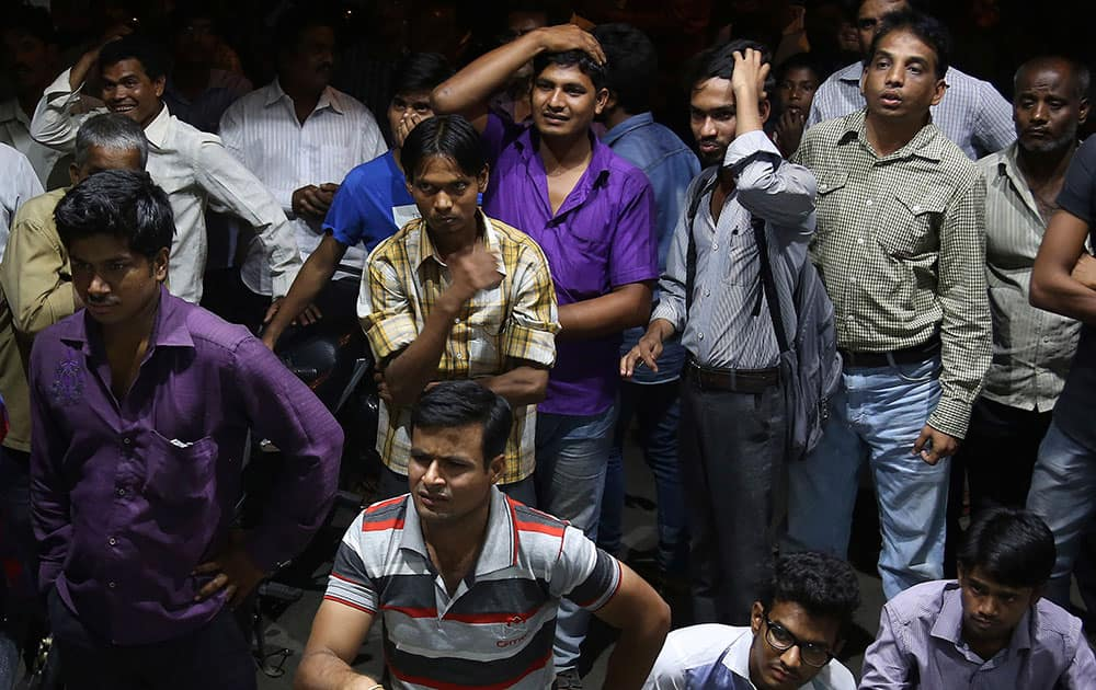 Cricket fans react as they watch the ICC World Twenty20 2016 cricket semi-final match between India and West Indies in Hyderabad.