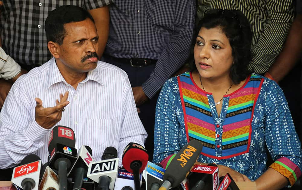 K Panduranga Rao, left, group head of human resources and administration, and Sita, legal head of IVRCL, the company that was constructing the underpass in Kolkata.