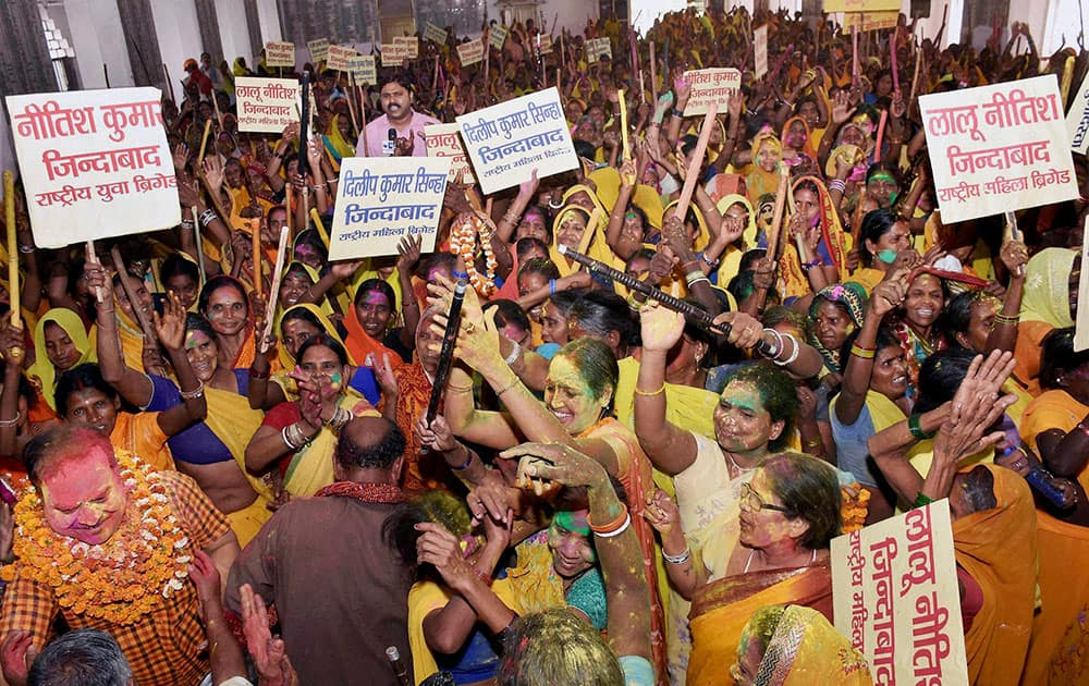 Mahila Brigade activists celebrate after Bihar government ban country made liquor in Patna.