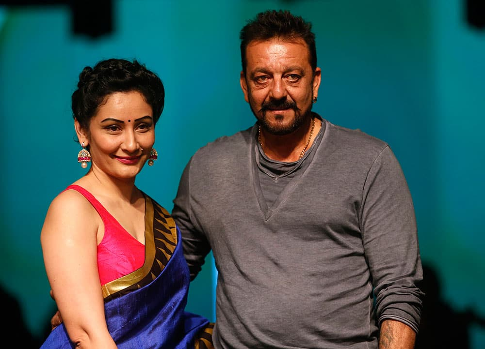 Bollywood actor Sanjay Dutt and his wife Manyata pose for the media during the Lakme Fashion Week in Mumbai.