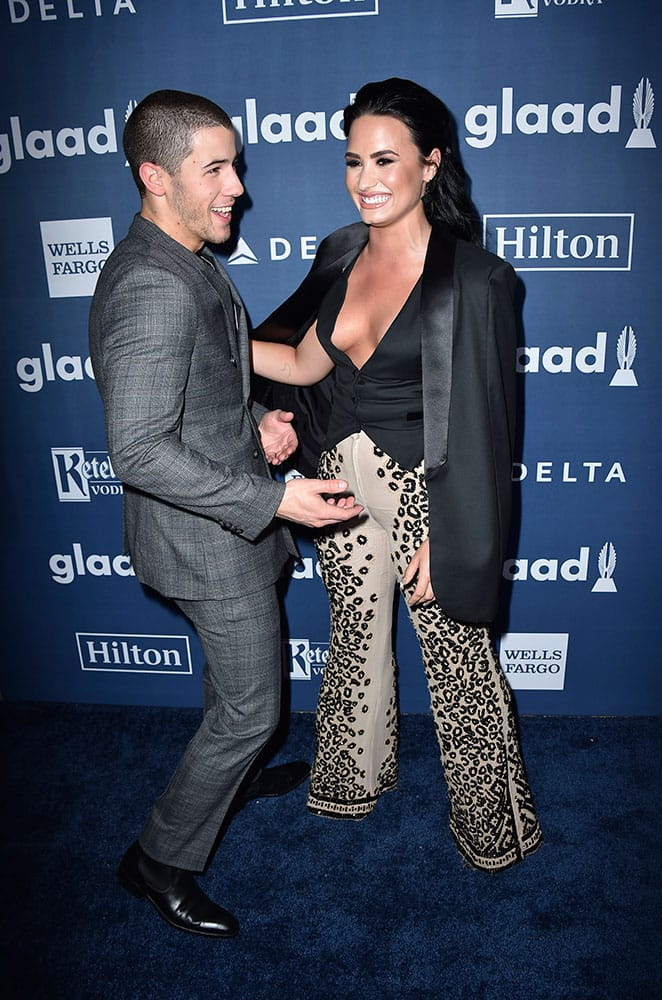 Nick Jonas, left, and Demi Lovato arrive at the 27th Annual GLAAD Media Awards at the Beverly Hilton in Beverly Hills, Calif.