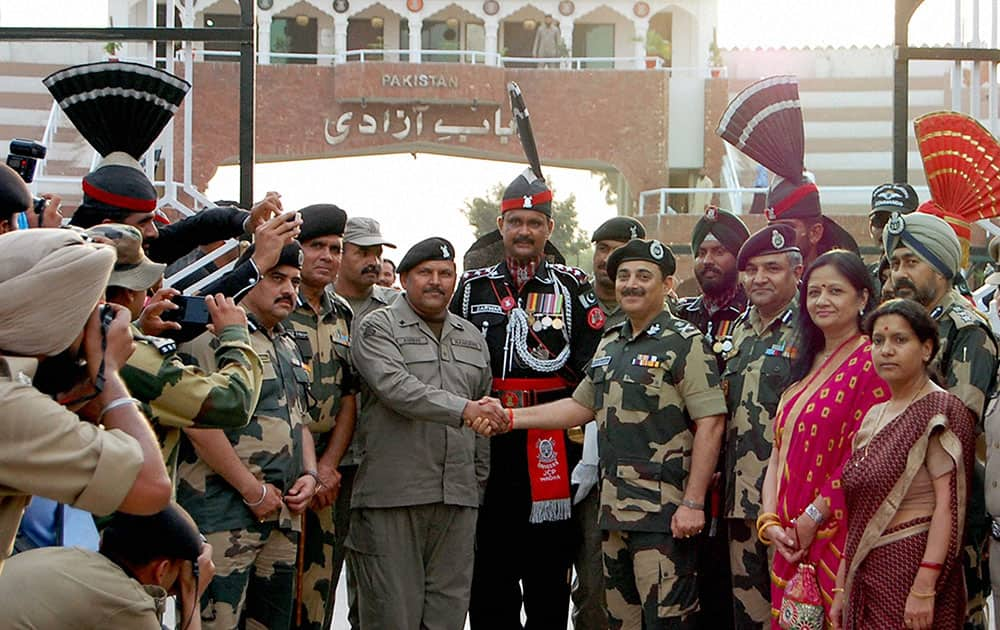 BSF DG KK Sharma giving fruits basket to his counterparts of Pakistan Rangers from Attari international border during his visit on Saturday.