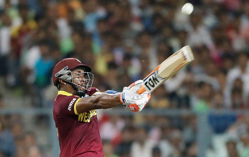 West Indies Dwayne Bravo bats during the final of the ICC World Twenty20 2016 cricket tournament against England at Eden Gardens in Kolkata.