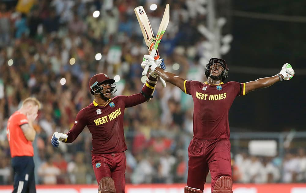 West Indies Carlos Brathwaite celebrates with teammate Marlon Samuels after they defeated in England in the final of the ICC World Twenty20 2016 cricket tournament at Eden Gardens in Kolkata.