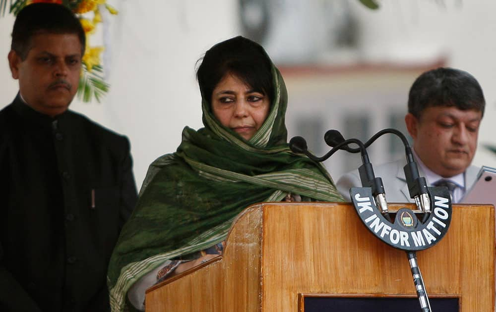 Kashmir Chief Minister Mehbooba Mufti takes the oath of office during a ceremony in Jammu